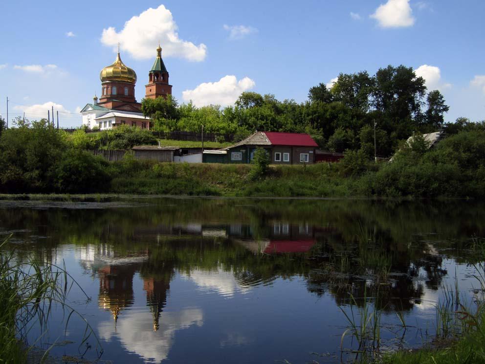 Вид на Богоявленскую церковь с противоположного берега Пышмы. Фото Алексея Рычкова